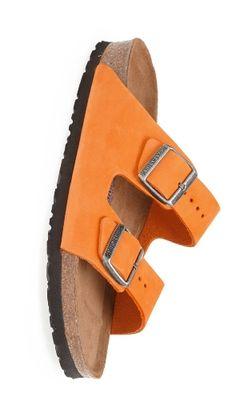 Orange Birkenstocks.