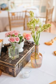pretty peach centrepiece with vintage accents and old bottles, love x