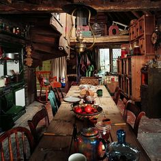 """Prior to Harry Potter and the Half-Blood Prince, only ground-floor interior sets, such as the kitchen, existed for The Burrow, while all exterior shots were generated with CGI. """"We wanted everything - from the furniture through to the crockery on the kitchen table - to look as if it had been bought in second-hand shops, picked up at swap meets, or rescued from curbs."""" - Stephenie McMillan #TriviaTuesday #BehindTheScenes #HarryPotter #TheBurrow #TheWeasleys #FilmWizardryBook…"""