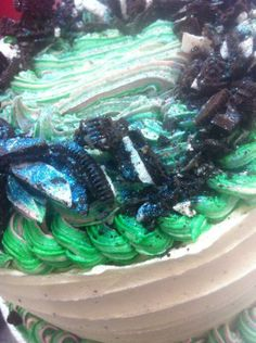 Green piped icing and broken Oreos
