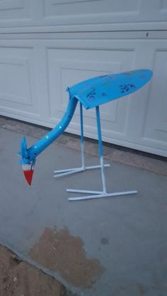 Shovel bird. old shovel rebar and paint