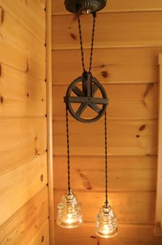 Oh my! I have to figure out a way to do this! I LOVE it! Industrial Vintage Pulley & Insulator Hanging Light