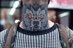 Wolf throat tattoo.