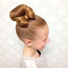 """""""Super cute bun with a hair bow by @hairbykatiegunnell.  Perfect way to spice up a ballet bun! ❤️"""" Photo taken by @braidsforlittlegirls on Instagram, pinned via the InstaPin iOS App! http://www.instapinapp.com (03/26/2015)"""