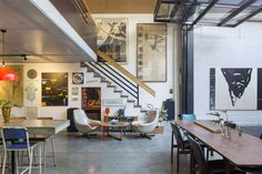 I'm stalking an artist's studio and home with suspended concrete, open ceilings and clear span space. There are mezzanine floors, plywood walls, a glass tilt door and walls crammed with amazing art. It's a bit gritty, a bit grubby and it's fabulous - Stalking old school warehouse conversion - desire to inspire - desiretoinspire.net