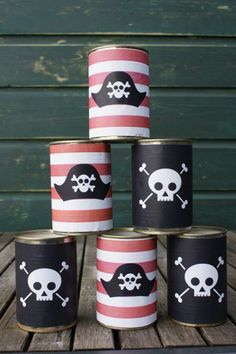 edccc02a10b Play this fun pirate bowling game at your pirate party. An easy DIY party  game to make out of old tin cans.