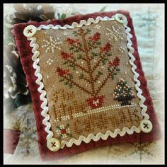 Little House Needleworks 2012 Ornament 6 Six Little Cardinals - Cross Stitch Pattern. Model stitched on 30 Ct. cocoa linen with DMC floss. Stitch Count: 45x63