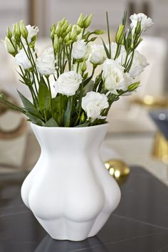 Jonathan Adler - Kiki's Derriere Vase. A feminine piece of porcelain that she can store her flowers in.
