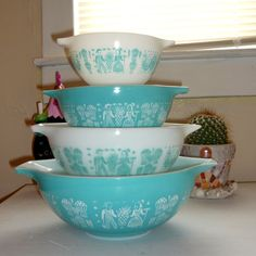 """butterprint"" pyrex bowls from the & got my set for a wedding gift.with a set of matching covered casserole dishes."