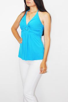 Tunic by Sky is the color of the Ocean a beautiful Turquoise. Braided halter tie to the neck then double ties from neck dangle down the back. Braided bands wrap around just below the bust with a flattering circle detail in front. Pair with white denim and wedges for a Sunday brunch.    Turquoise Tunic Top  by Sky. Clothing - Tops - Tunics Florida