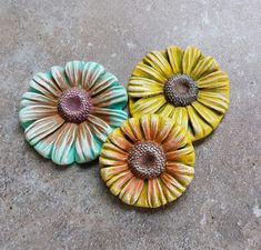 Polymer clay daisy flowers by Sandra DeYoung Niese