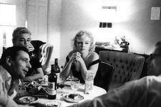 Beverly Hills, California. 1960. Yves Montand, his wife Simone Signoret, Marilyn Monroe and her husband Arthur Miller at the Beverly Hills Hotel.  By Bruce Davidson