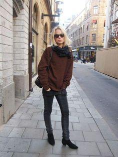 Brown knits, blonde hair.