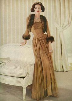 September Vogue 1956 - would also look gorgeous with long-flowing hair, as opposed to this more dated style. Love the color, and the pops of fur on the bolero top.