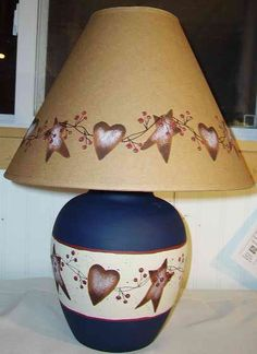 Primitive Country Rusty Tin Stars and Hearts Stoneware Table Lamp. Professionally designed and created in the USA. Pattern continues around entire lamp for display from any angle of your room. Primitive Lamps, Primitive Country Crafts, Primitive Painting, Primitive Stars, Pintura Country, Country Lamps, Country Decor, Prim Decor, Rustic Decor
