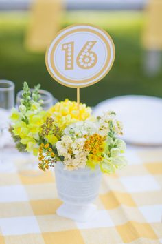 Centerpiece and table number. Photography by emilyscannell.com, Floral Design by violaflowers.com. #ThePerfectPalette