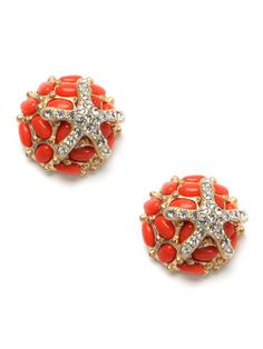LOVE! Tiny though they may be, these studs pack a big punch. They feature chic crystal-covered starfish sunning atop bright coral-like studs—actually beautiful chunks of beaded and bejeweled gold.
