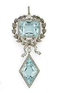 A GOLD AND SILVER-MOUNTED AQUAMARINE AND #DIAMOND PENDANT BROOCH BY FABERGÉ, WITH THE WORKMASTER'S MARK OF AUGUST HOLLMING, ST PETERSBURG, 1899-1903, SCRATCHED INVENTORY NUMBER 76389 A rectangular-shaped aquamarine within silver-cast laurel wreath surmounted with a rose-cut diamond and tied with ribbon below, suspending a lozenge-shaped aquamarine within a gold-mounted rose-cut diamond border, with suspension loop, in the original case stamped 'Fabergé St Petersburg Moscow, Odessa'