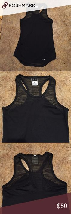 Nike Dri-Fit Asymmetrical Mesh Cutout Top Very unique! Asymmetrical seems and mesh cutouts on front and back. Never worn, perfect condition. Nike Tops