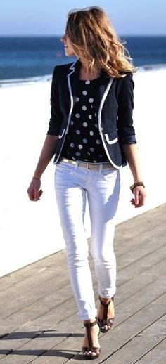 Navy fitted blazer, blouse, white pants, cream belt, gladiators.