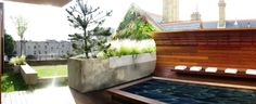 Roof top garden with bespoke curved seating area and water feature