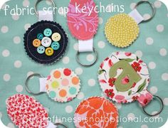 Fabric Scrap Key Chains  I want to use these when wrapping gifts. These will help dress up a present I need to mail. Bows and ribbon are always oddly flattened. These seem a good alternative.