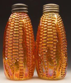 """CARNIVAL CORN PAIR OF SALT AND PEPPER SHAKERS, marigold, each with period two-part lids. Possibly Imperial Glass Co. First quarter 20th century. 4 3/4"""" and 4 5/8"""" HOA."""
