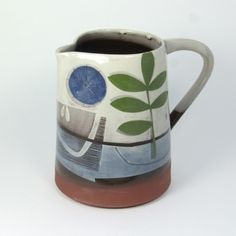 Karen McPhail, slip decorated jug with leaves and a blue sun. #ceramics, #pottery