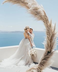 Pampas Grass Arch + Chic Bridal Gown for Modern Bride, Intimate and Luxurious Elopement in Santorini #wedding #elopement #bride #weddingdress #weddingideas #travelinspiration #santorini