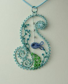 Ocean Wave wire wrapped sea themed pendant with free matching earrings. £32.00, via Etsy.