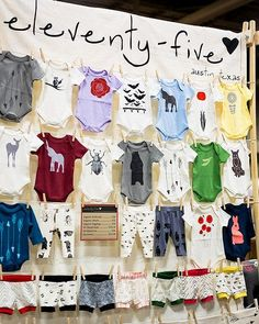 Baby clothes! All laid out, nice and clean. And a sign with pricing. Renegade Craft Fair Flickr stream. 2014 Holiday Show Austin