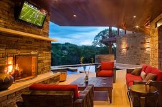 living room with open view, pool and fireplace
