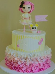 cute Lalaloopsy Cake. Kind of looks like Crumbs Sugar cookie, except wrong colors for the dress.