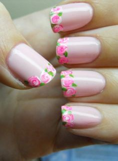 These are so gorgeous! Im assuming you put on a rose dust Dolores polish, tape off the top of the nails with a French manicure sticker, then using the water marble technique with pink & white, apply that in three little dobs. Then just add the leaves wit
