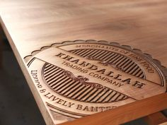 Khandallah Trading Co. Laser etched table tops