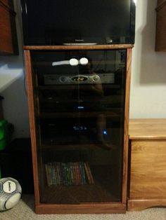 Base cabinet for entertainment center