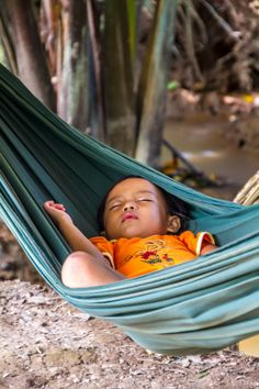 Sleeping child in Can Tho, #Vietnam. Get more information on this destination along the Mekong River: http://www.citypassguide.com/destination/can-tho