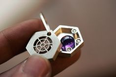 Magnet silver locket  https://www.normaldott.com/jewelry
