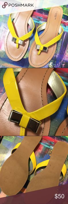 """☀️ Coach Yellow Patent Bow Flip Flop ☀️ Like a ray of sunshine, but for your toes!😀 These coach flops say,""""I like the flips but I'm high class 😜"""" There's a gold metal bow that adds to the shoes beauty. There are some creases and small wear. The creases will lessen as you wear them. Great condition. Only worn a few times! 💁🏾✨Happy Poshing!😀  🌟 Suggested User 🌟 🙋🏾 Top 10% Sharer/Mentor ⭐️⭐️⭐️⭐️⭐️ 5 star Gal 📫 Fast Shipper!  Ships Same/Next Day📦  🏡 Odor Free 🐩 Pet Free 🚫…"""