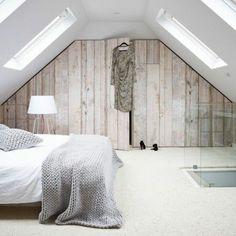 meuble sous pente, armoire en pente dans une chambre à coucher attique