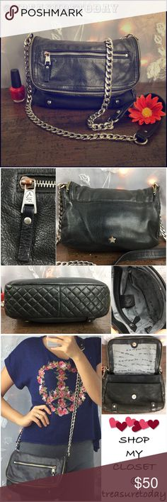 ASH Black Leather Chain Cross Body Bag Good Used condition. Some tarnish on the hardware. Wear on the leather part of the shoulder trap.  Leather shoes normal signs of use. Interior shows moderate wear. Small size ,Heavy chain. Zipper detail on the flap closure. Ash Bags Crossbody Bags