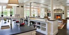 Separation b/w kitchen & great room with bottom shelf and counter, step down to great room? Off set cook top island deep enough to eat on, sink on wall, coffered great room ceiling