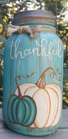 Hand drawn & painted by me. No stencils, all freehand work . I hope you enjoy this jar that i painted on two sides for Fall & Winter decor! Just simply turn around ! This is a new Anchor Glass quart size jar, & comes with a vintage Ball zinc lid May be Mason Jar Projects, Mason Jar Crafts, Fall Mason Jars, Halloween Mason Jars, Mason Jar Christmas Crafts, Mason Jar Pumpkin, Mason Jar Kitchen Decor, Rustic Mason Jars, Pot Mason Diy
