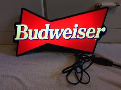 A personal favorite from my Etsy shop https://www.etsy.com/listing/519194552/vintage-budweiser-beer-lighted-sign