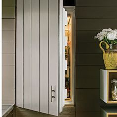 Vertical, not horizontal, planks cover the refrigerator, making it unobtrusive but not hidden. Refrigerator Makeover, Refrigerator Decoration, Refrigerator Covers, Outdoor Refrigerator, Beach Cottage Style, Beach House, Barn Kitchen, Kitchen Dining, New Mexico Homes