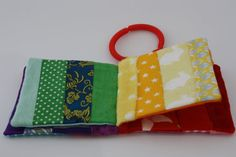 Mini rainbow colour fabric book baby toy by StitchARainbow on Etsy