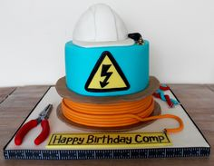 cake for electrician with tools and hat