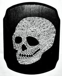 - Side view of skeleton in white string on a black wooden plaque. - This string art piece is a must have for your halloween decor! If your a skull fanatic like some people I know, hang it up year roun