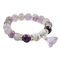 """Дамска еластична гривна от естествени камъни 10 мм мъниста. Камъни: Ахат, Аметист. Кристал Сваровски с размер 15 мм. Нежно всекидневно дамско бижу, подходящо за приятен сюрприз на любимото момиче. Код: SB5.Онлайн #бижутерия """"Изискани"""", гр. #Русе:  #Гривна с естествени камъни #ахат, #аметист и лилав кристал #Сваровски https://www.iziskani.com/grivna-ot-estestveni-kamyni-nefrit-sedef-avanturin-sb5.html"""