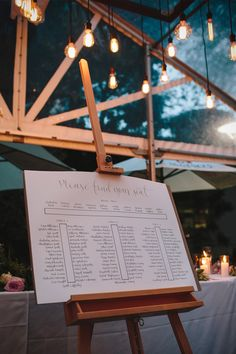 Handlettered seating chart for long table wedding | Merge Photography